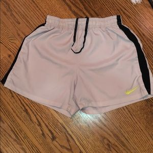 White Nike running shorts